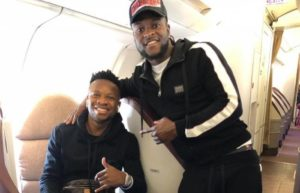 Victor Moses bumps into Ogenyi Onazi in the plane after Fenerbahce victory